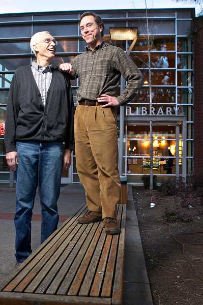 by: TIMES PHOTO: JAIME VALDEZ - At nearly 7 feet tall, Paul Teyler, left, rarely has to look up anyone. But his life was recently saved by Sean Garvey, right, a librarian at the Tigard Public Library, who helped give him CPR after he had a heart attack in January.