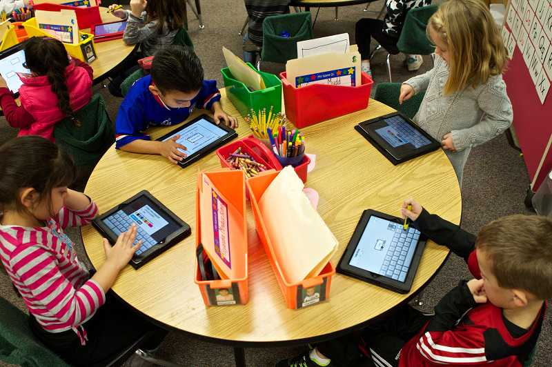 by: TIMES PHOTO: JAIME VALDEZ - Alejandra Mendoza Romero, Jorge Ruiz, Sammy Mudd and Carson Miller are kindergartners in Leslie Kolbs class who use iPads to complete their classwork.