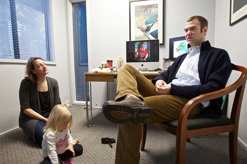 by: TIMES PHOTO: JAIME VALDEZ - Allison and Jeremy Schubert, and 2-year-old Eleanor relax in their small Tigard office. The couple train local businesses how to use Facebook and Twitter, and help them manage their social media presence.
