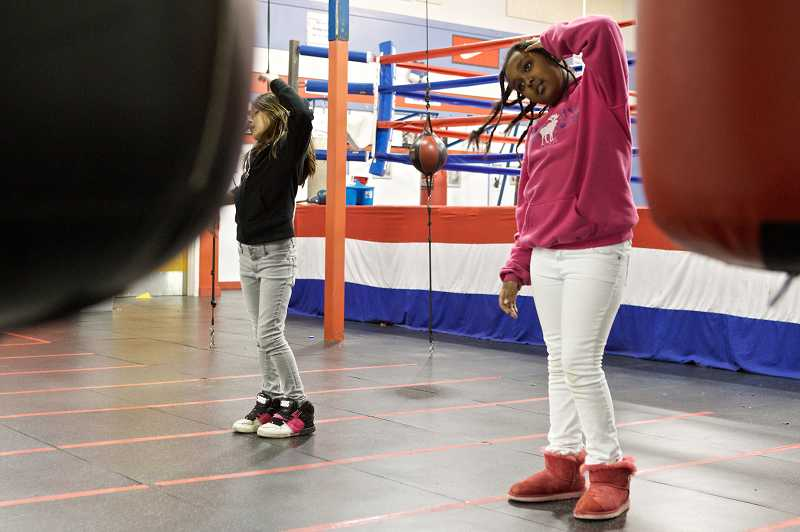 by: TIMES PHOTO: JAIME VALDEZ - Samantha Ramirez, 10, and Anna Abraham, 9, practice dance moves during a hip hop class at the Beaverton PAL center.