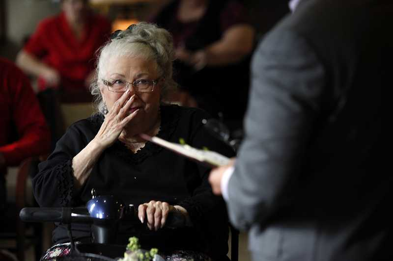 by: TIMES PHOTO: JONATHAN HOUSE - Mary Evans tears up during her wedding ceremony with Don Murphy at Creekside Village in Beaverton.