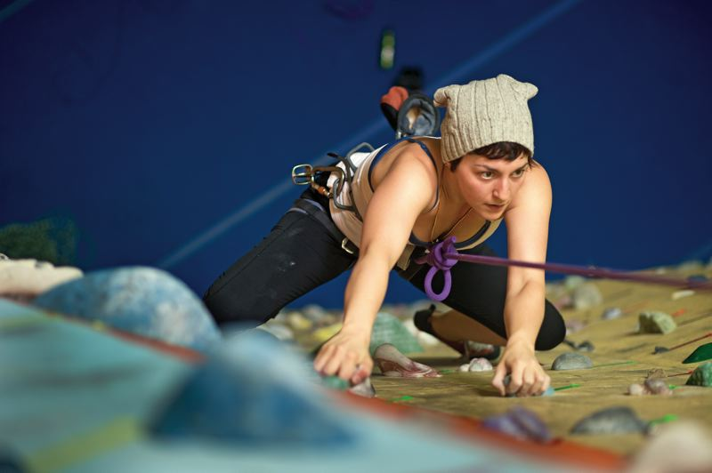 by: TRIBUNE PHOTO: CHRISTOPHER ONSTOTT - More women are rock climbing, like Melissa Heller, while learning their skills at places such as Portland Rock Gym, which celebrates its 25th anniversary this year. It was the second indoor climbing center in the country to open, in 1988.