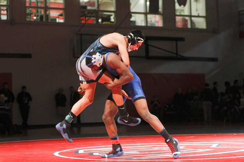 by: CHASE ALLGOOD - GOT HIM - Aloha's Maurice McSwain picks up Century's Carlos Mendez during his 5-4 championship win at 160 pounds on Saturday night.