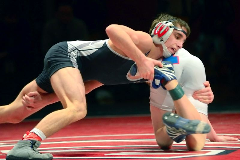 by: MILES VANCE - BACK TO STATE - Westview junior Joel Timmons grapples with Hillsboro's Matt Peterson during his win at 106 pounds on Saturday at Westview High School.