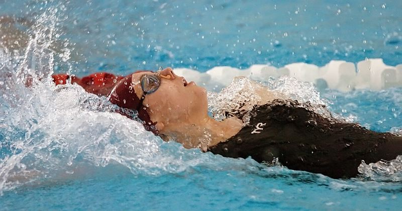 by: DAN BROOD - RECORD BREAKER -- Sherwood senior Emily Stevens is on her way to setting a new school record in the 100-yard backstroke event during Saturday's Class 5A state swim meet finals.