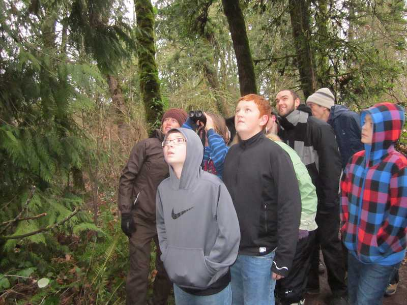 by: BARBARA SHERMAN - UP THERE - Looking at a screech owl in the Tualatin River National Wildlife Refuge are (from left) Gardiner Platt, TRNWR environmental education specialist, and Sherwood Middle School students Zak Carson, Cole Schaefer and Liam Burgess.