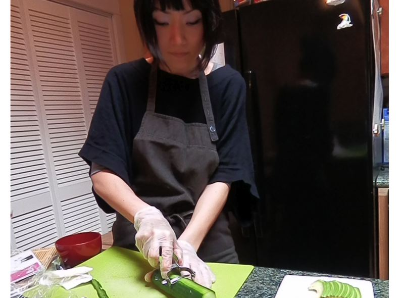 by: HILLSBORO TRIBUNE PHOTO: DEEDA SCHROEDER - Miki Willis demonstrates how even a novice can make sushi at home.