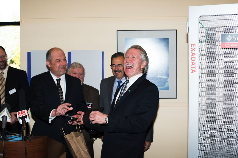 by: TRIBUNE PHOTO: CHASE ALLGOOD - Gov. John Kitzhaber laughs as he is gifted a Oracle Team USA hat by Oracle Vice President Luke Kowalski. Behind them from left are Washington County Chair Andy Duyck, Metro President Tom Hughes and Hillsboro Mayor Jerry Willey.