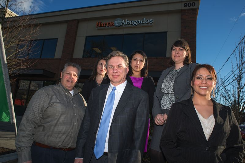 by: TRIBUNE PHOTO: CHASE ALLGOOD -  The staff of the Harris Law Firm in Hillsboro at their recently opened bilingual branch. Front row, left to right: Paul Vames, Rob Harris, Veronica Vazquez. Back row: Sarah Freeman, Vianey Diaz Conway and Amy Velazquez.