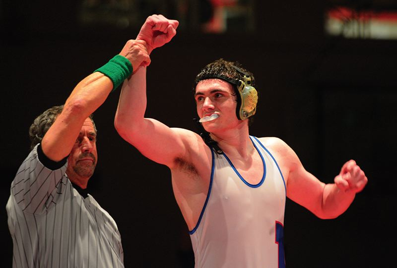 by: TRIBUNE PHOTO: CHASE ALLGOOD - Hillsboro sophomore Ben Kociemba celebrates after winning a 195-pound district championship on Saturday at the Special District 1 wrestling tournament at Westview High School.