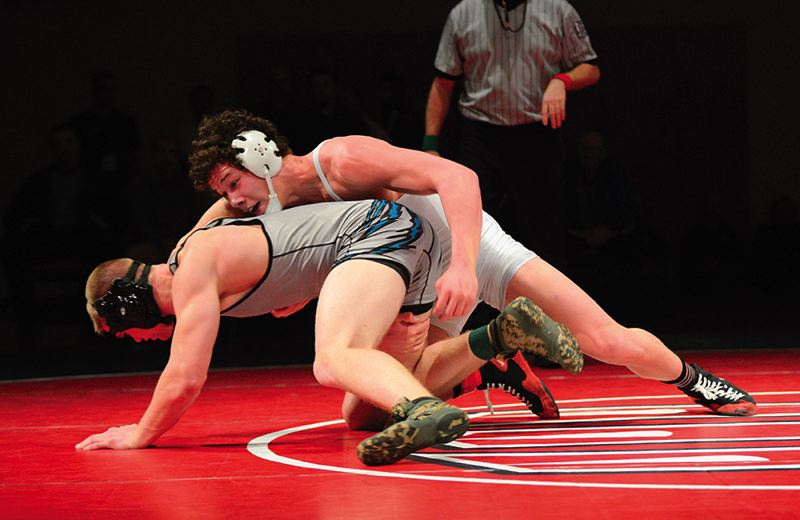 by: TRIBUNE PHOTO: CHASE ALLGOOD - Hillsboro senior John Morin wrestles Century's Bret Wilson during the 182-pound championship match at the Special District 1 wrestling tournament, held last weekend at Westview High School in Beaverton.