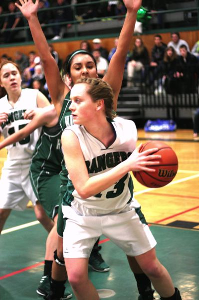by: NEWS PHOTO: LOREN NIBBE - Senior Madison Haga scans the court as a La Salle defender guards.