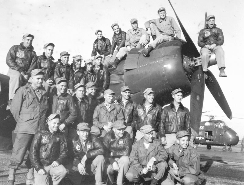 by: PHOTO: COURTESY OF SAL STROM - This photo shows Sal Strom's father, Marine Capt. Richard Strom (far left), and his squadron with their Corsair aircraft during World War II.