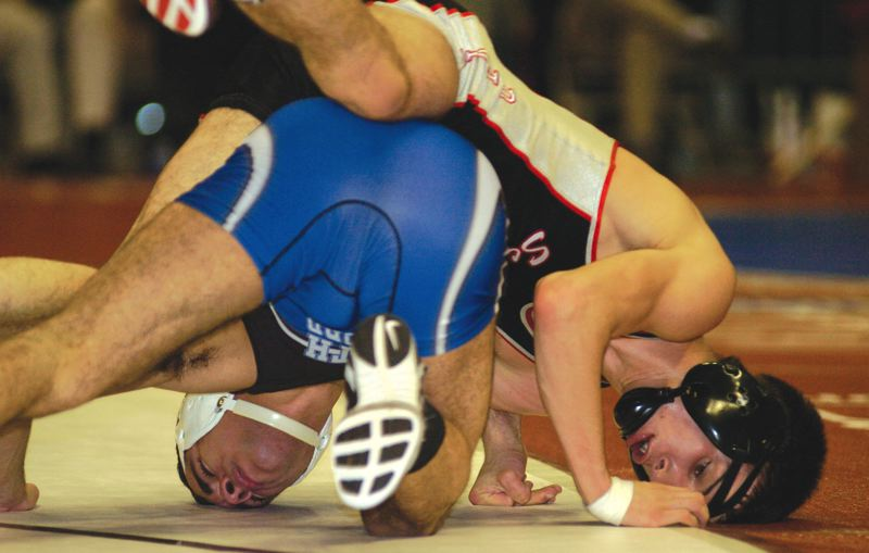 by: THE OUTLOOK: DAVID BALL - The Scots Ricky Molinari secures a takedown before going out of bounds during his 6-0 win over South Medfords Ruben Mendez in the second round Friday.