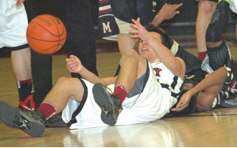 by: THE POST: PARKER LEE - Sandys Karsten Short passes from his back and covering a loose ball during Fridays loss.