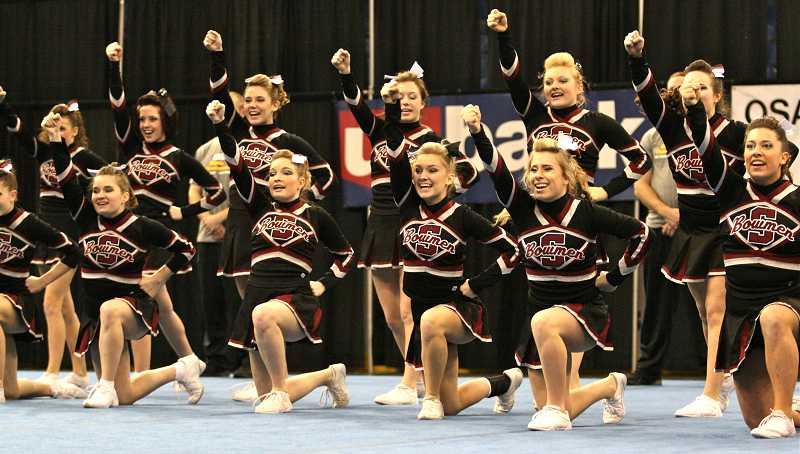 by: BRIAN MONAHAN/PAMPLIN MEDIA GROUP - SHS cheerleaders perform at state competition. They include, back row from left, Emily Matlock, Meghann Dempsey, Sierra Gieber, Gabbie Hall, Tiffani Wilson, Cambria Rooney; front row, Belle Bobbitt, Mikalie Poff-Sanders, Ellie Hockett, Kamila Harbick and Claire Reeder.
