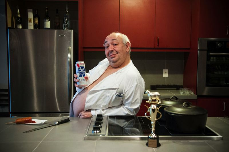 by: PHOTO COURTESY: EATER - French-born Pascal Sauton poses with a can of Pabst, a cigarette behind his ear and a provocative outfit to bring the 'Hottest Chef' title to Milwaukie.