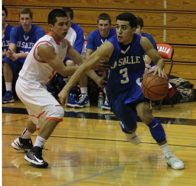 by: COLIN STORM - Senior point guard Alex Soberanis (3) goes on the attack in last weeks Tri-Valley Conference showdown at Molalla. Jack Marquardt defends for the Indians.