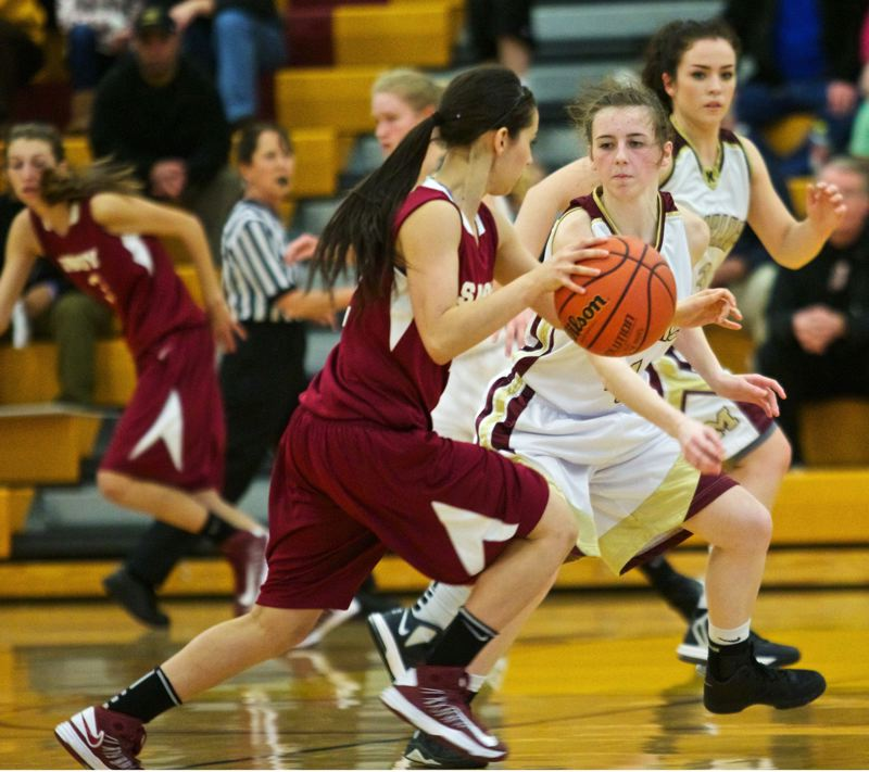 by: JAIME VALDEZ - Milwaukie senior Hana Whisman defends against Sandy junior Paola Phipps in last Fridays game with the Pioneers. It was an historic night for the Mustangs, who wrapped up their first undefeated league season in school history with a 71-46 rout of the Pioneers.