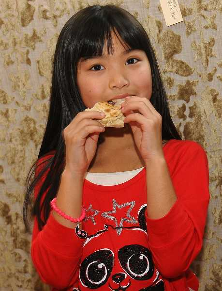 by: VERN UYETAKE - Jada Bell, a student in fourth grade, enjoys sampling Indian food.