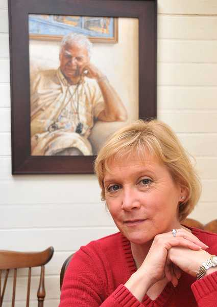 by: VERN UYETAKE - Beth Sautter poses in front of her own portrait of her friend, famed artist Arnie Westerman. The painting reveals a lot about his character.