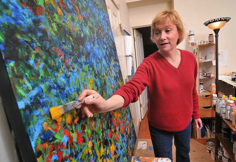 by: VERN UYETAKE - Beth Sautter is shown working on one of her most colorful creations. Although she specializes in portraits, she likes to branch out occasionally.