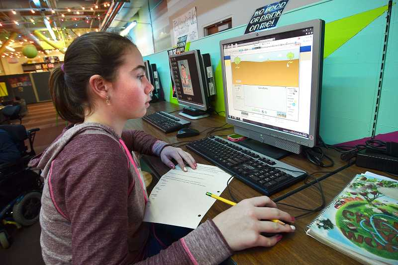 by: VERN UYETAKE - Teen Lounge can be a great place to learn as well as have fun. Here, Isabella Hoffman works on a school science project.