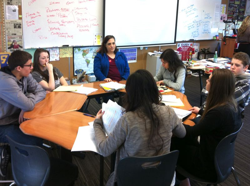 by: POST PHOTO: LISA K. ANDERSON - Sandy students collaborate with Karen Mockrin, a volunteer attorney from Tualatin.