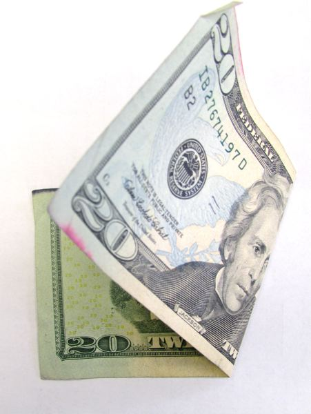 by: SPOTLIGHT FILE PHOTO - It is more usual for police to see counterfeit $20 bills, but the fake $100 bills like the ones St. Helens investigators are looking at now are not uncommon.