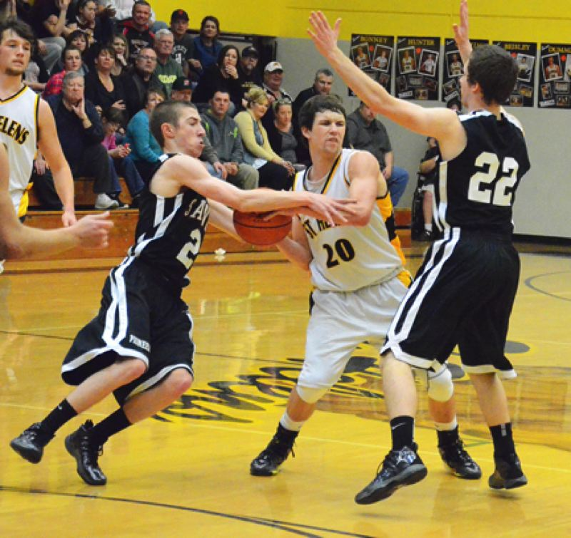 by: JOHN BREWINGTON - St. Helens' Cody Beisley looks for an outlet as he gets mugged by Sandy's Scooter Turin (2) and Karsten Short. The Lions lost to Sandy but beat Parkrose Friday and hosted a play-in game with Summit Tuesday.