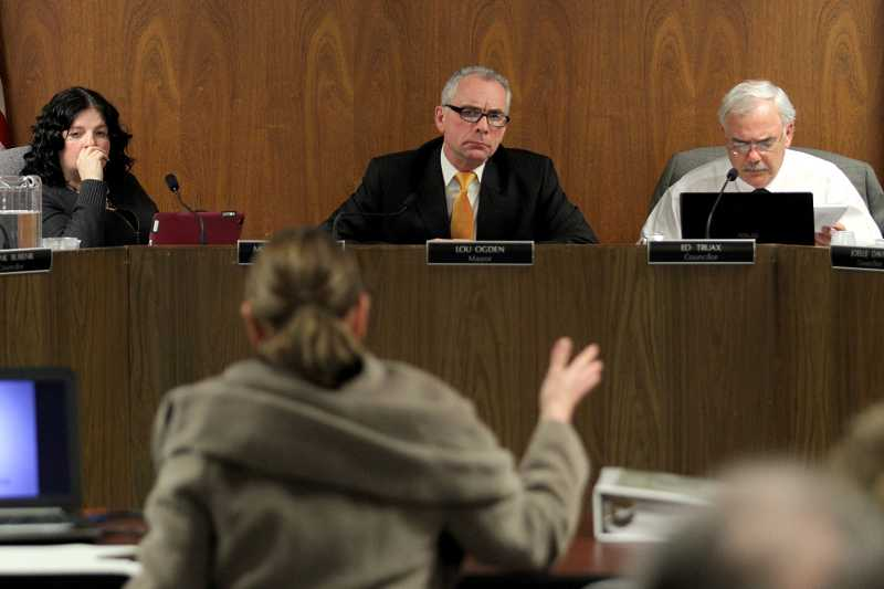 by: TIMES PHOTO: JONATHAN HOUSE. - Tualatin Mayor Lou Ogden, center, and Councilor Ed Truax, along the rest of the council, listen to testimony during a Feb. 11 public hearing about the Transportation System Plan update. Both men voted against its approval Monday night.