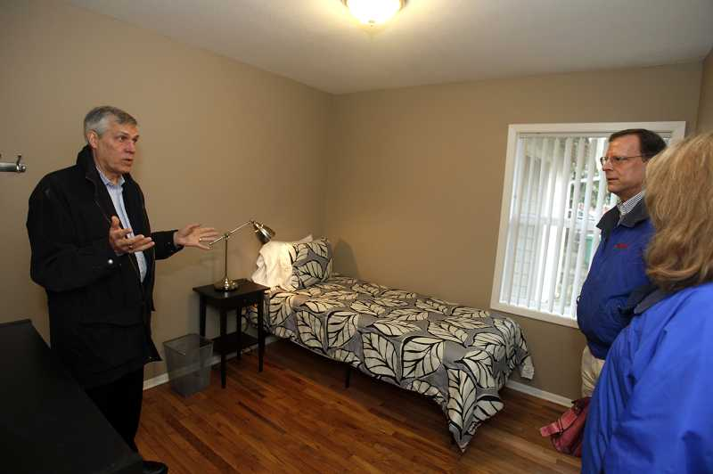 by: TIMES PHOTO: JONATHAN HOUSE - Boys and Girls Aid CEO Michael Balter shows off a new bedroom that a homeless youth in Beaverton moved into this week, thanks to multiple organizations and the city of Beaverton.
