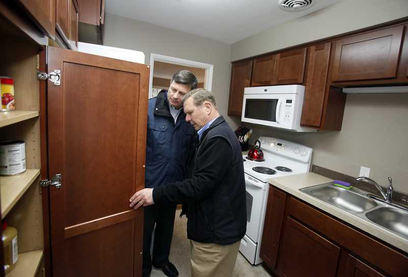 by: TIMES PHOTO: JONATHAN HOUSE - Dan Gerrone, center, and Roger Neu check out the remodeled kitchen of Beaverton's new Boys and Girls Aid transition home.
