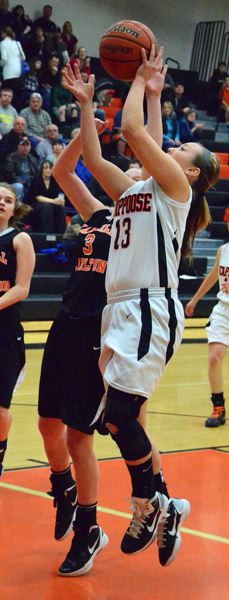 by: JOHN BREWINGTON - Scappoose's Cassidy Hoglund goes up with a jumper during last week's Cowapa League playoff game with Yamhill-Carlton. Scappoose lost to visiting YC, 34-32, and missed a chance for the state play-in round.