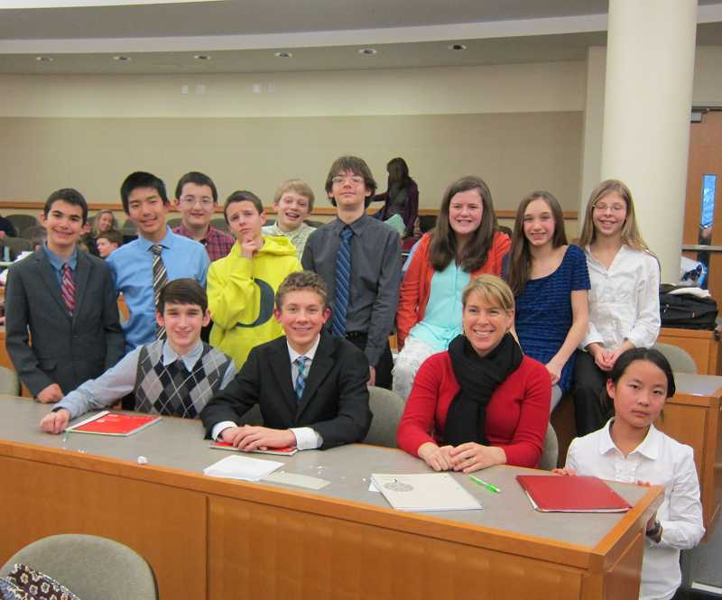 by: SUBMITTED PHOTO - SUBMITTED PHOTO Members of the Lake Oswego Middle School debate team include, top row from left, Sam Doby, Jinghui Lou, Kyle Padgett, Drew Jackson, Andrew Gates, Zander Work, Jane Griffiths, Julia Lininger-White and Danielle Work. Seated from left, Adam Lininger-White, Jackson Dyal, teacher Aletia Cochran and Doris Yang.