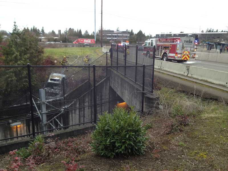 by: SUBMITTED PHOTO: BPD - Tualatin Valley Fire & Rescue crews extinguish a car fire Tuesday afternoon near the Sunset Transit Center light-rail tunnel.