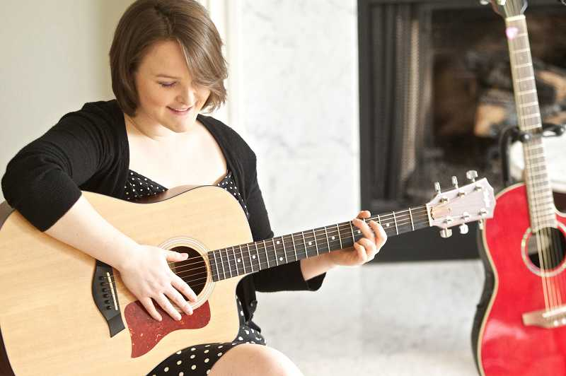 by: TIMES PHOTO: JAIME VALDEZ - Singer-songwriter Hannah Beth Dedlow performs a song from her recently released first album, Just a Dream, at her parents home in Tualatin.