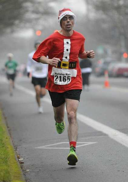 by: COURTESY OF JASON ZACHER - Jason Zacher, seen here in a holiday half marathon race, hopes to make it from Portland to Lincoln City in 21 hours on Saturday.
