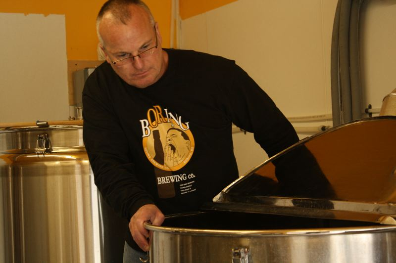 by: POST PHOTO: JIM HART - Boring Brewing Co. owner John Griffith inspects the contents of his heated brew tank.