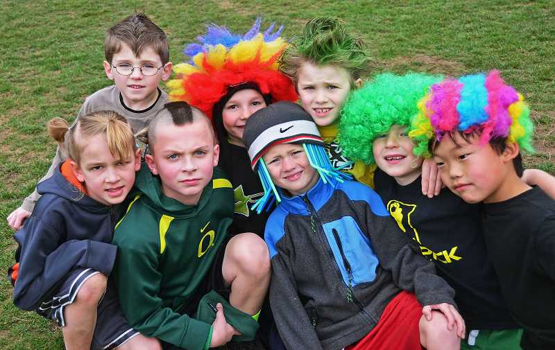 by: TIDINGS PHOTO: VERN UYETAKE - Boys sported wigs, hats and mohawks as part of the crazy hair day. From left to right are Jake Johansen, Devon Naranjo, Erik Hoffberg, Bodie LaForce, Jonny McCoy, Mitchell Rowe, Masson Spicer and Issac Noesen.