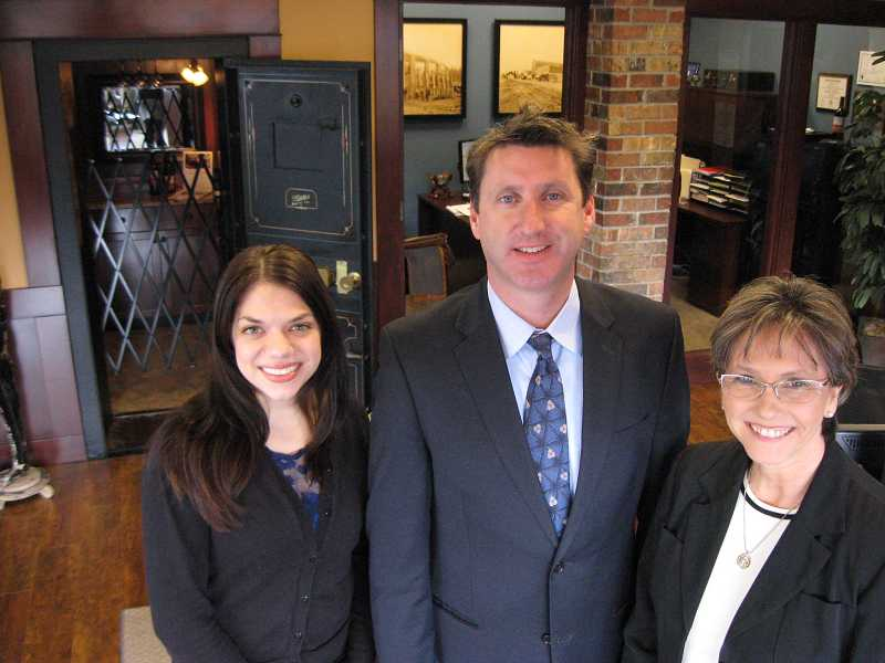 by: RAY PITZ - SERVING SHERWOOD - Bank of Oswego Sherwood Business Banking Center will feature services provided by, from left Essie Bertain, customer service representative; Tim M. Heine, branch vice president and senior lending officer; and Dianne Snyder, bank relationship manager.