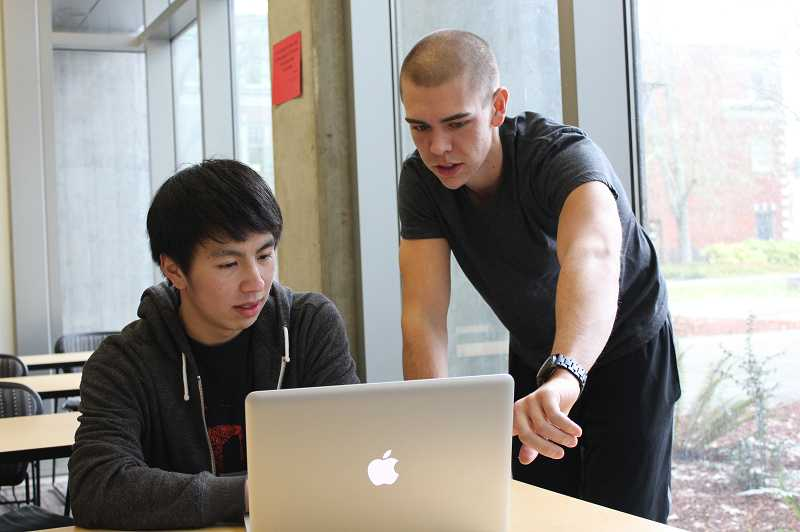 by: SUBMITTED PHOTO: RACHEL ROBERTSON - Godfrey Yeung, left, is participating in the App Hackathon organized by Ryley Herrington, right, to learn how to develop mobile applications.