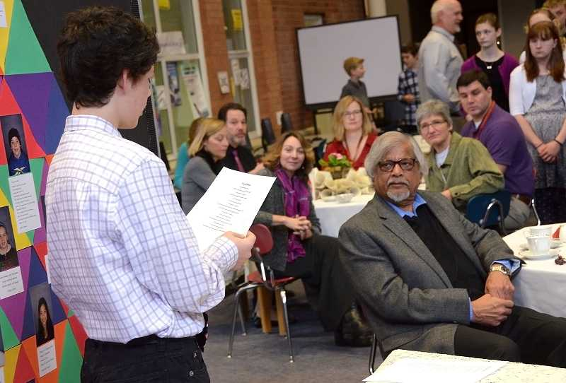 by: TIDINGS PHOTO: VERN UYETAKE - Athey Creek seventh-grader Miles Noscato reads a poem he wrote to Arun Gandhi.