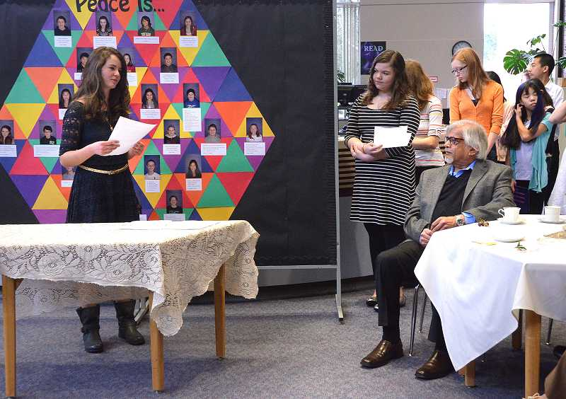 by: TIDINGS PHOTO: VERN UYETAKE - Sara Pauline VanNiekerk, an eighth-grader, read a poem she prepared to Arun Gandhi.