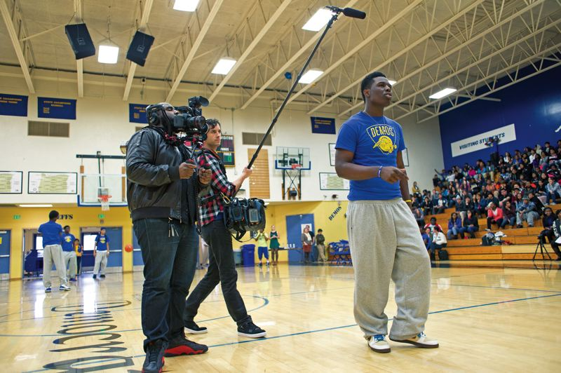 by: TRIBUNE PHOTO: CHRISTOPHER ONSTOTT -  A film crew follows Jamartae Brown during a pep rally before the Benson game.