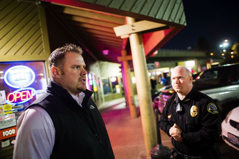 by: TRIBUNE PHOTO: CHRISTOPHER ONSTOTT - Dan Fischer (left), owner of the Dotty's chain, has hired security guards at the Hayden Island Lottery Row businesses. Fischer declined to comment on the new employee lawsuit about docking pay when cash register tallies come up short.