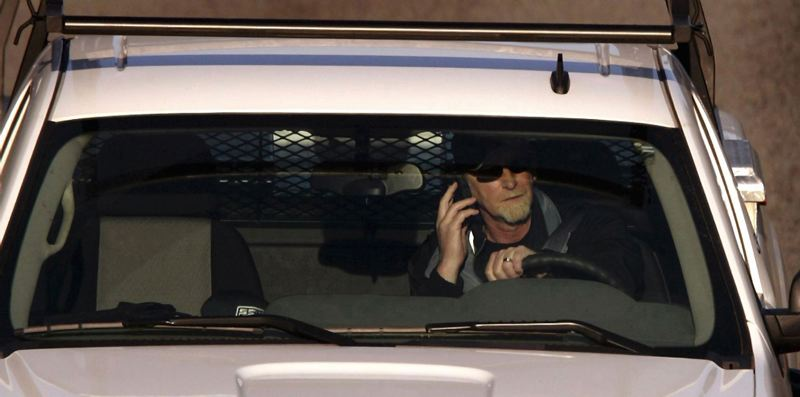 by: TRIBUNE FILE PHOTO: L.E. BASKOW - A rush hour driver on the Sunset Highway talks on his cell phone. Oregon lawmakers are set to increase fines for texting or talking on a cell phone while driving.