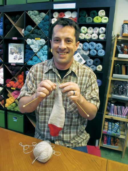 by: PAMPLIN MEDIA GROUP PHOTO: ELLEN SPITALERI - Daniel Yuhas demonstrates the 'secret rock star' knitting technique for making socks with two needles. Yuhas taught himself to knit while attending Oberlin College in Ohio.