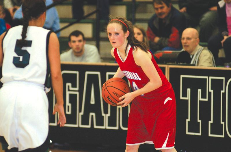 by: THE OUTLOOK: DAVID BALL - Centennial guard Melissa Dailey looks for an open passing lane during Wednesdays 57-42 playoff loss at Tigard.
