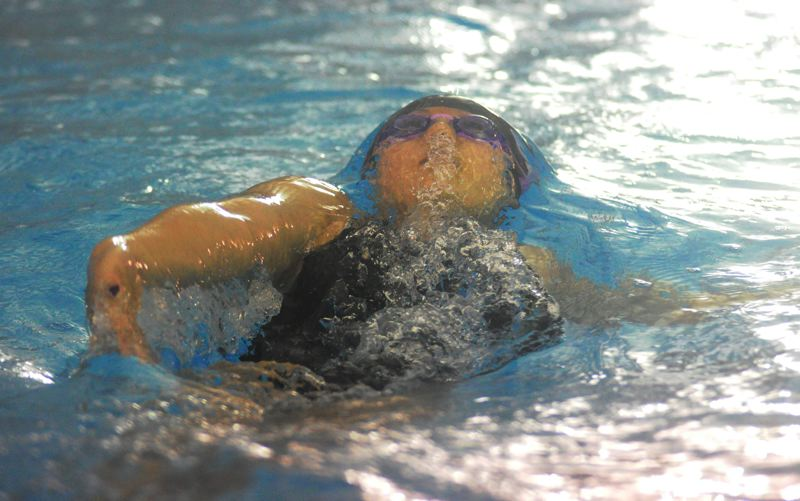 by: MATTHEW SHERMAN - Lakeridge's Brenda Cha comes up for a breath during the individual medley at last week's state swim meet.